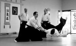 Aikido throw by senior martial art students at Austin Aikikai.